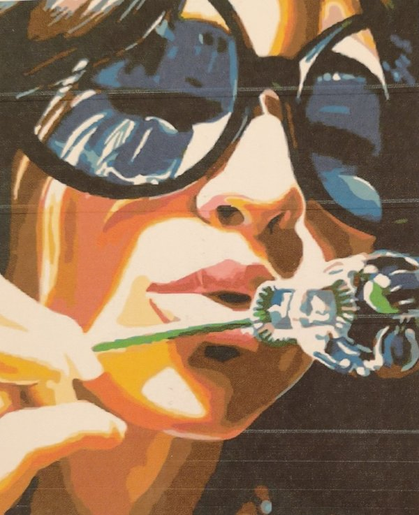 Lady with sunglasses blowing bubbles