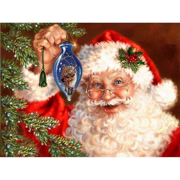 Santa Claus with Christmas ornament